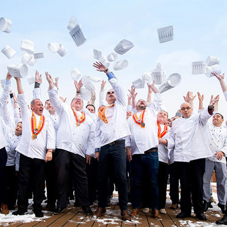 Chefs tossing their hats